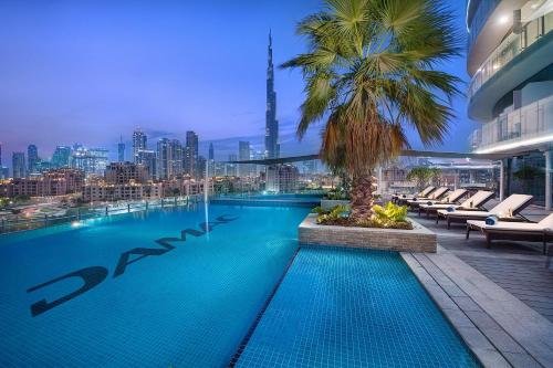 The swimming pool at or near DAMAC Maison Distinction
