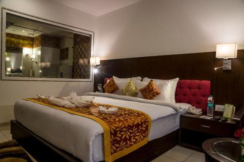 Hotel Udai Medianにあるベッド