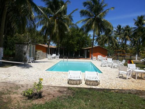 The swimming pool at or near Village Mangue Seco