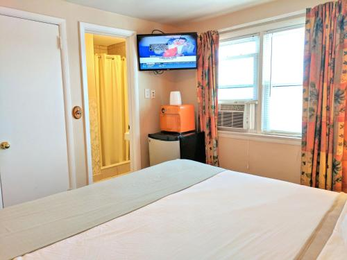 A bed or beds in a room at Clarem Happy Days