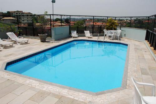 A piscina localizada em Edifício Ônix Residence - 302 ou nos arredores