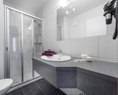 Ein Badezimmer in der Unterkunft Appartements Zahnleiten