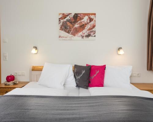 Ein Bett oder Betten in einem Zimmer der Unterkunft Appartements Zahnleiten