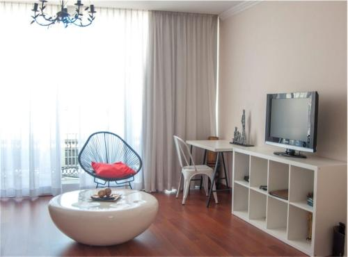 A television and/or entertainment centre at Hotel Central Boutique