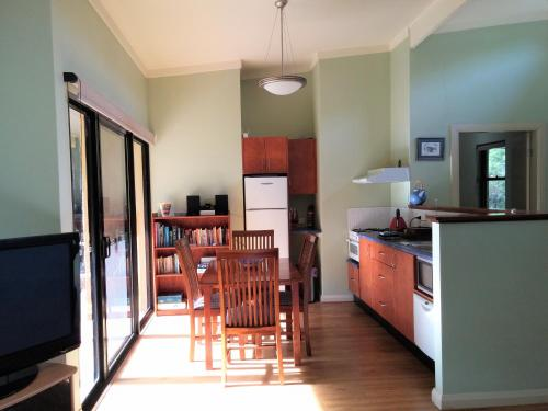 A kitchen or kitchenette at Milton Country Cottages
