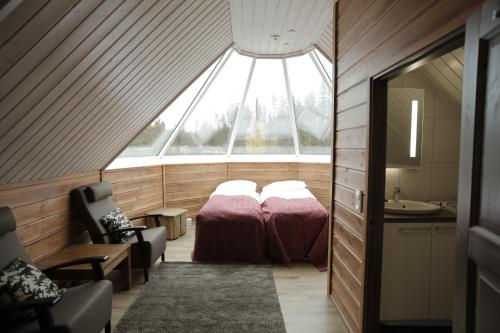 A bed or beds in a room at Levi Northern Lights Huts