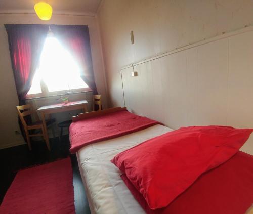 Säng eller sängar i ett rum på STF Storliens Fjällgård