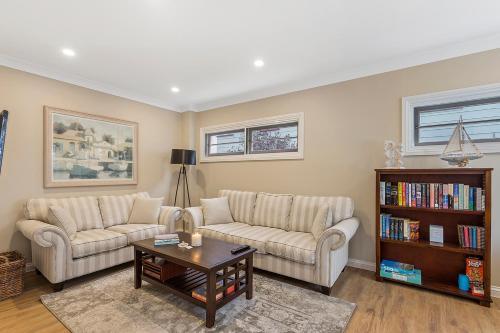 A seating area at Hamptons at The Bay