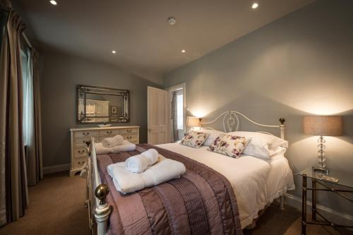 A bed or beds in a room at Dalzie