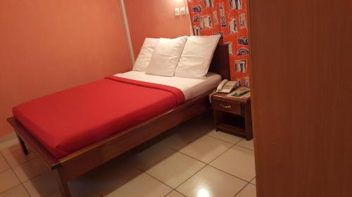 A bed or beds in a room at Résidence Saint-Jacques Brazzaville