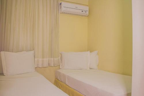 A bed or beds in a room at JOH Blue Ocean Flat Hotel