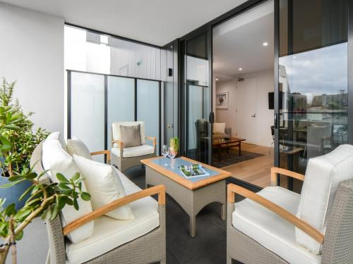 A seating area at Boutique Stays - The Lincoln, South Yarra Apartment
