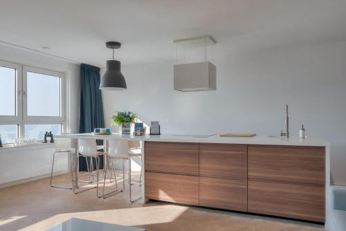 A kitchen or kitchenette at Nama-Stay