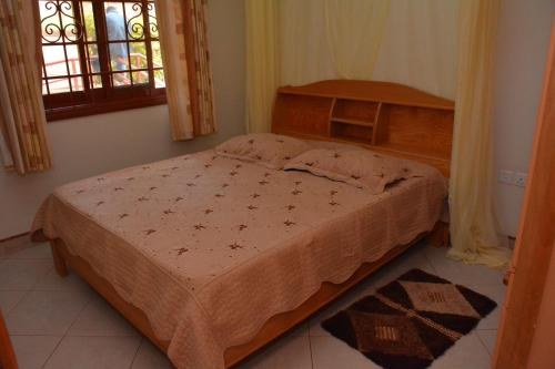 A bed or beds in a room at Kd Apartments Mediterranean Village