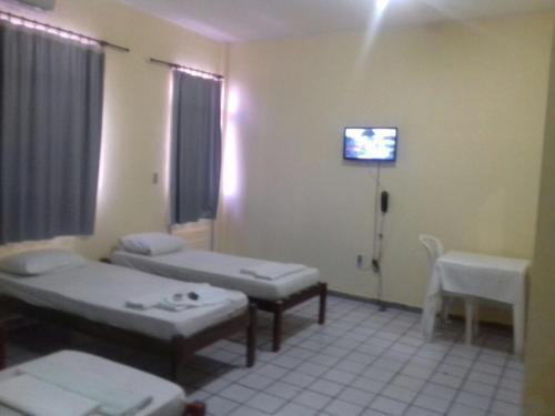 A bed or beds in a room at Pousada Marize Dantas