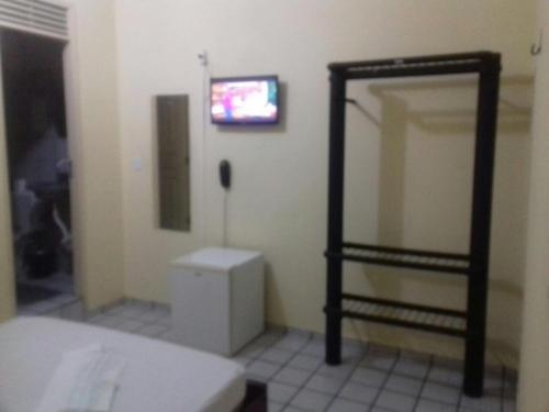 A television and/or entertainment center at Pousada Marize Dantas