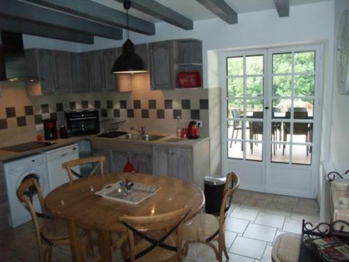 Cuisine ou kitchenette dans l'établissement Le Domaine du Grand Cellier Gîtes Appartement en Savoie