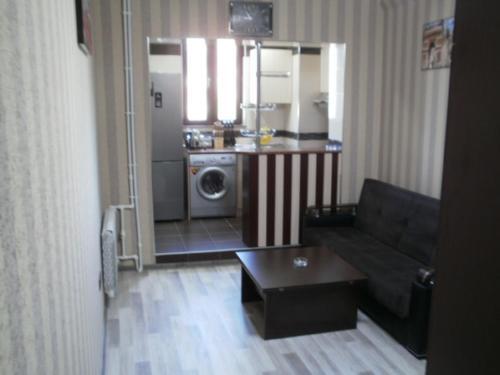 Uma área de estar em Apartment on Tbilisi Avenue