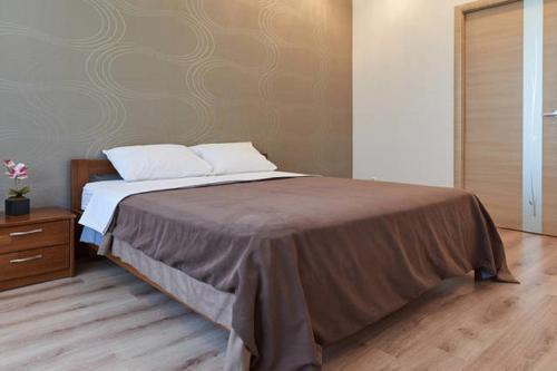 A bed or beds in a room at Сozy Kiev Apartment str Chernovola