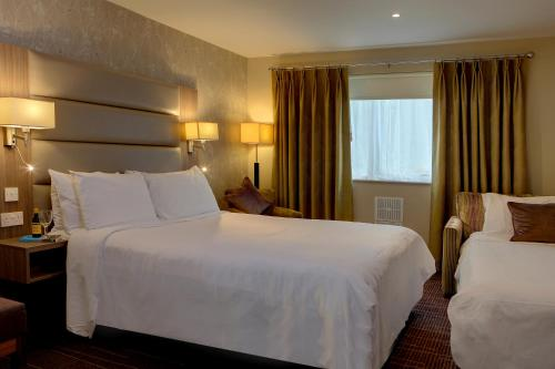A bed or beds in a room at Best Western Pontypool Metro Hotel
