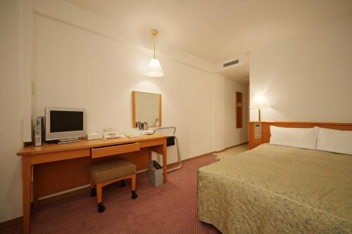 A television and/or entertainment center at Smile Hotel Nara