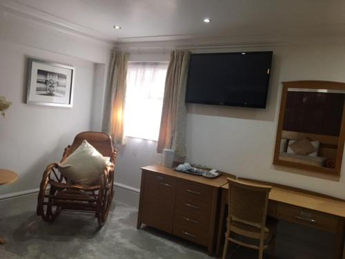 A television and/or entertainment center at Harefield Manor Hotel