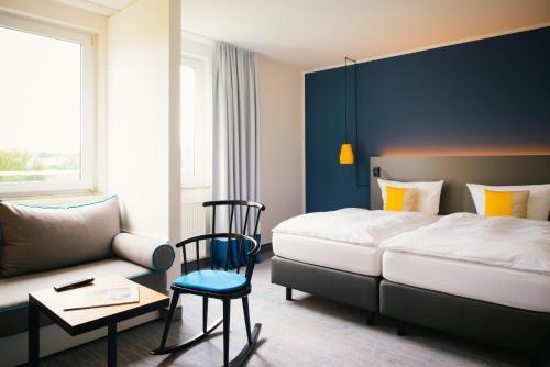 Ein Bett oder Betten in einem Zimmer der Unterkunft Vienna House Easy Amberg am Congress Centrum