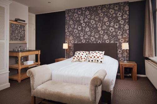 Een bed of bedden in een kamer bij Villa Westerduin