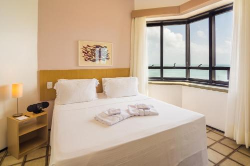 A bed or beds in a room at Golden Fortaleza by Intercity