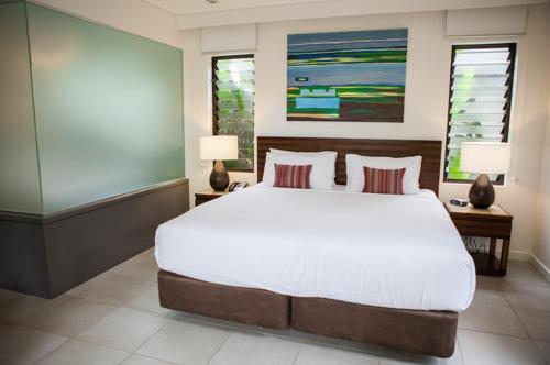 A bed or beds in a room at 161 SEA TEMPLE LUXURY DIRECT STUDIO