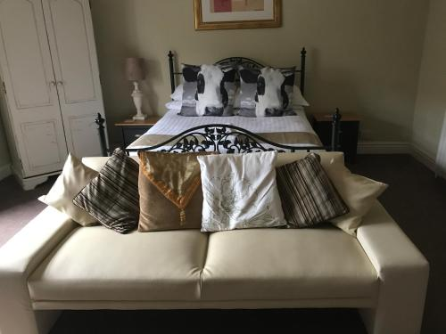 A bed or beds in a room at The White Bull Country Inn & Dining