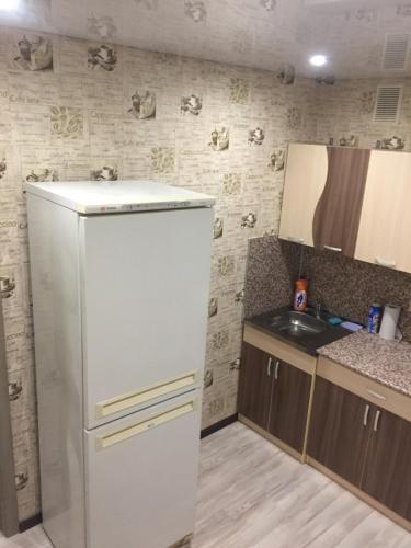 Кухня или мини-кухня в Apartment on Lenina 137