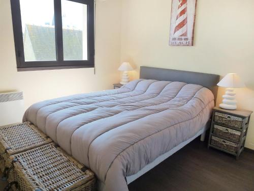 A bed or beds in a room at Apartment Baccara