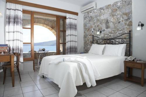 Кровать или кровати в номере Hotel Liakoto
