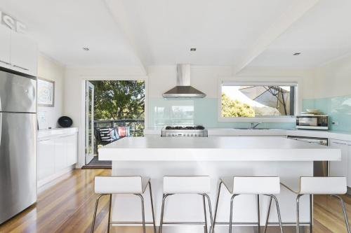 A kitchen or kitchenette at Front Beach House
