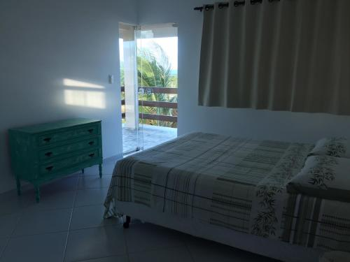 A bed or beds in a room at Relax Total Em Praia Bela