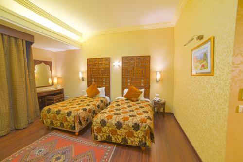 Кровать или кровати в номере Chtaura Park Hotel