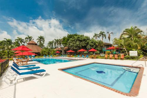 The swimming pool at or near Decameron Las Heliconias - All Inclusive