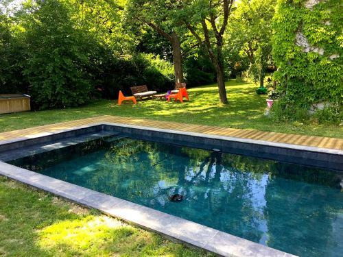 The swimming pool at or near La Sapinière de Vittel