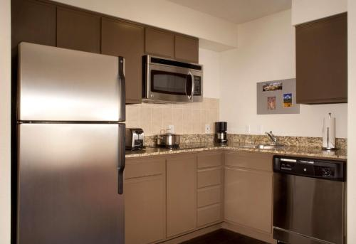 A kitchen or kitchenette at Hyatt House Colorado Springs
