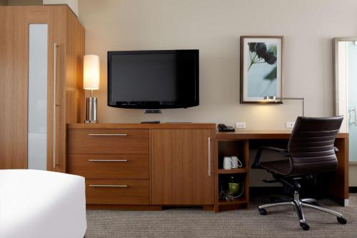 A television and/or entertainment center at Hyatt Place Chicago-South/University Medical Center