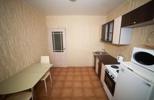 A kitchen or kitchenette at Apartments on Vesny