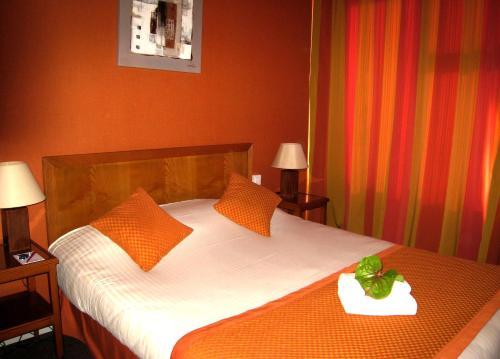 Un ou plusieurs lits dans un hébergement de l'établissement Le Grand Monarque