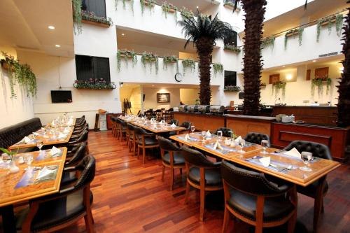 A restaurant or other place to eat at Harmoni Suites Hotel