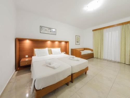 A bed or beds in a room at Zante Palace