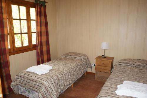 A bed or beds in a room at El Puente Aparts