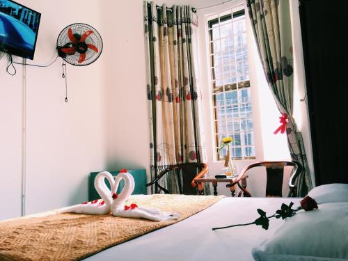 A bed or beds in a room at Thanh An Homestay
