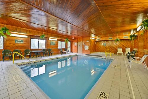 The swimming pool at or near Days Inn by Wyndham Topeka