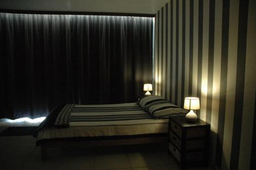 Un ou plusieurs lits dans un hébergement de l'établissement Studio De Zunneblomme