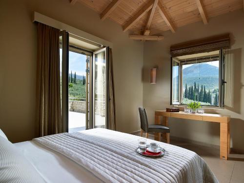 Ένα ή περισσότερα κρεβάτια σε δωμάτιο στο Anaxo Resort
